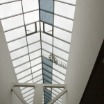 Commercial tinting of glass roof for solar heat reduction
