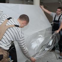 Kraft White Matte film installation on Athletic Gym windows